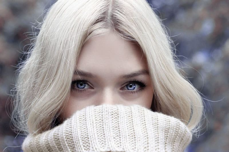 beautiful beauty blond woman covering her mouth