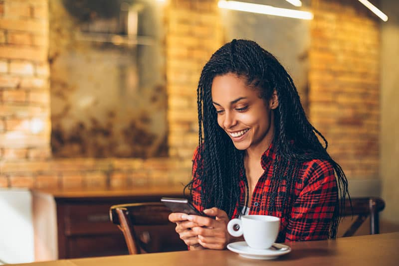 beautiful smiling woman texting