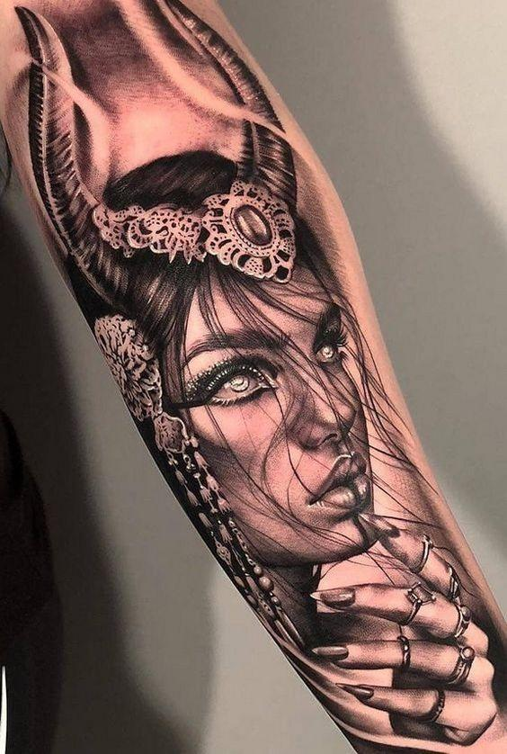 black and gray portrait of a stunning girl tattoo on the arm