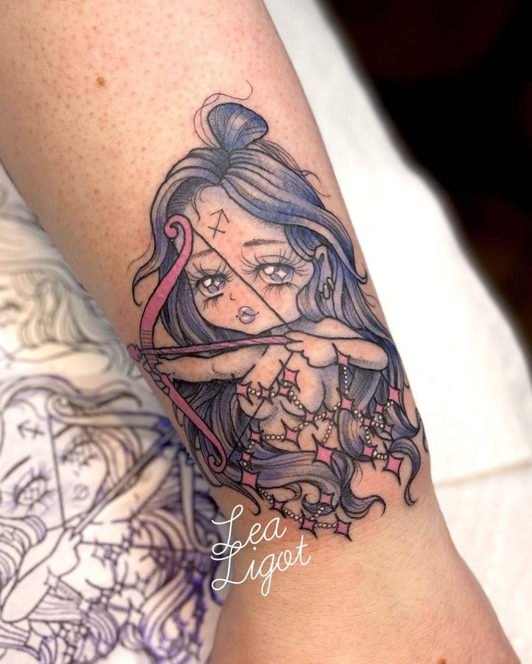 blue haired girl pulling an arrow tattoo on the arm