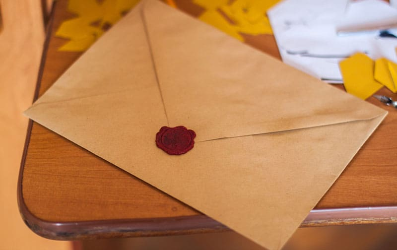 brown envelope on table sealed with red seal