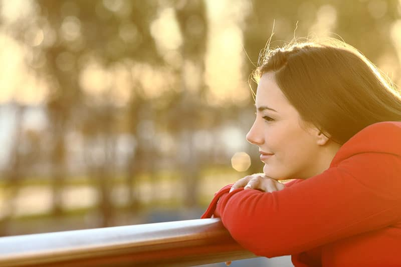 calm woman in red hoodie