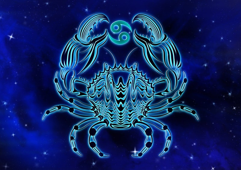 cancer zodiac sign on blue background