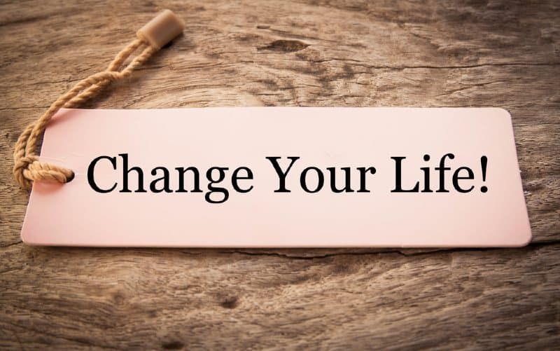 Change your life tag on wooden background