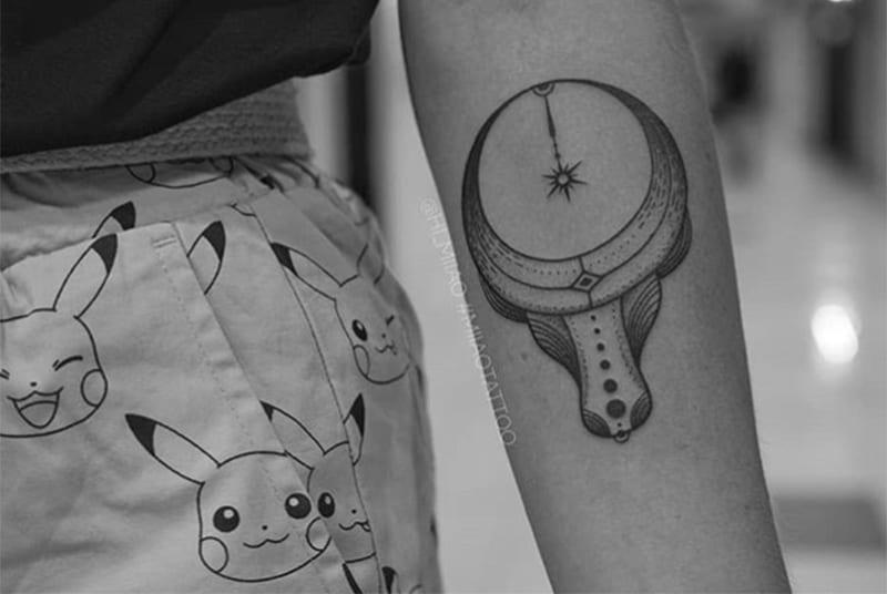 circular horns tattoo on the arm