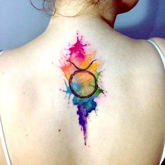 colorful watercolor taurus tattoo on the back