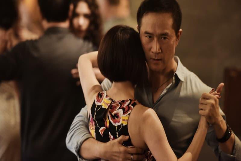 man and woman dancing indoor