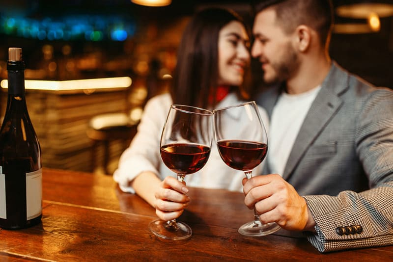 Couple on date night drinking from wineglasses