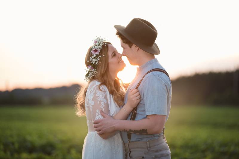couple facing each other on green grass