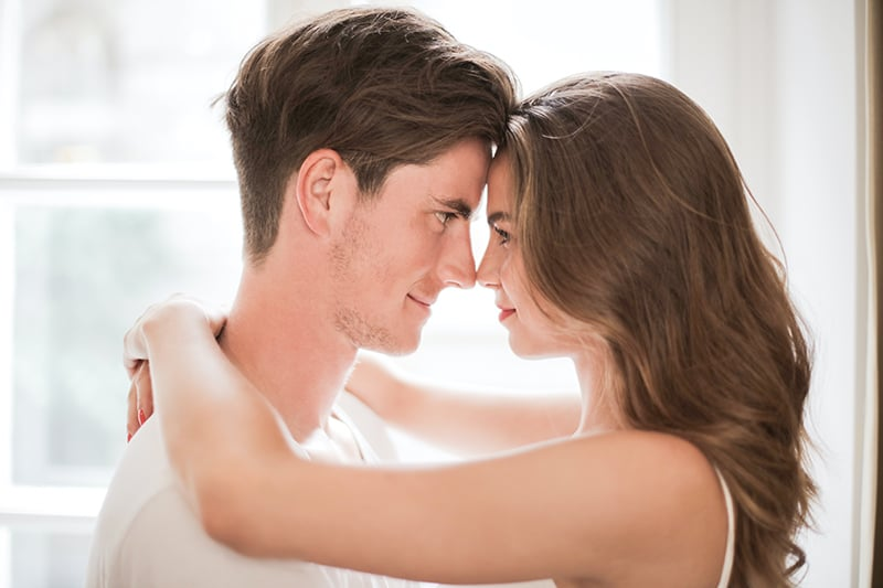 couple facing each other while smiling