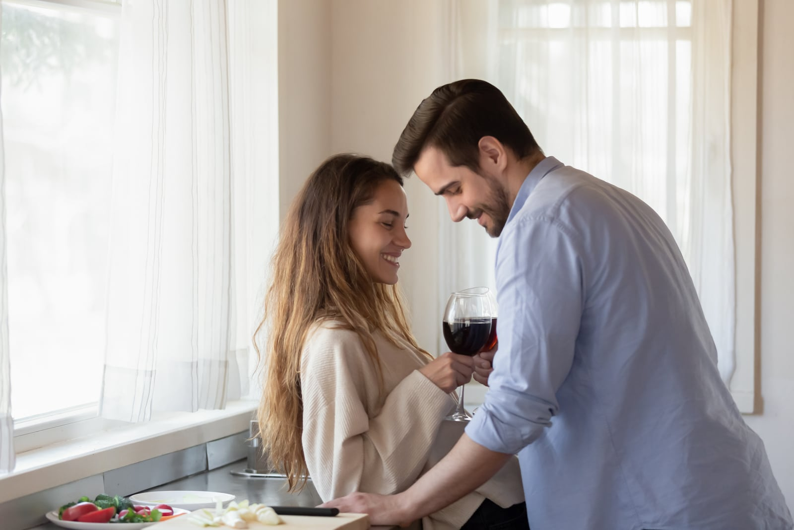 couple flirting in the kitchen