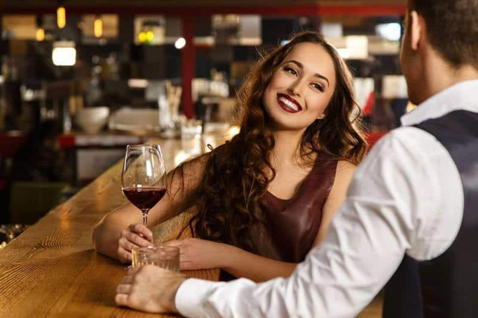 couple having conversation at bar