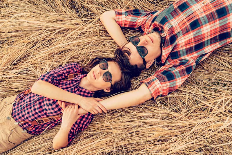 couple in love lying on the field