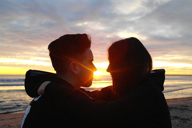 couple looking each other during the sunset
