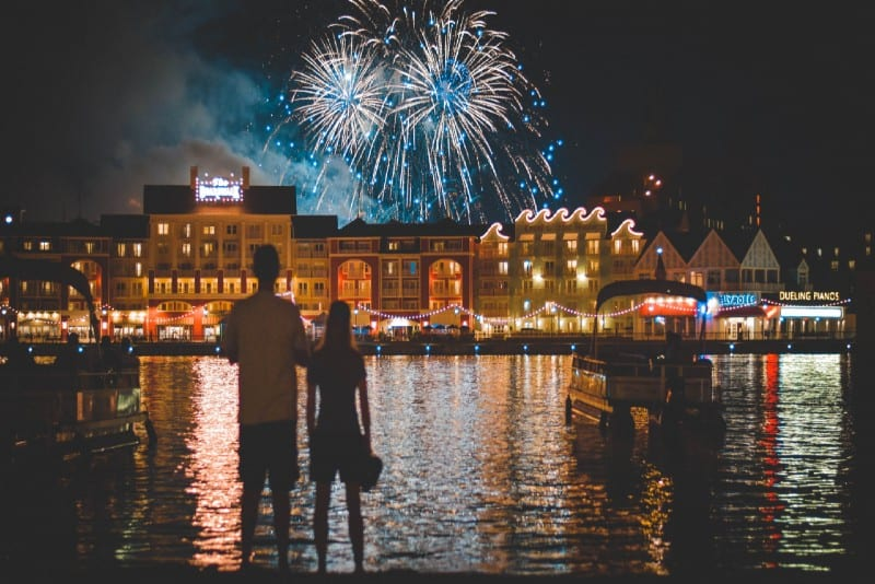 man and woman watching fireworks