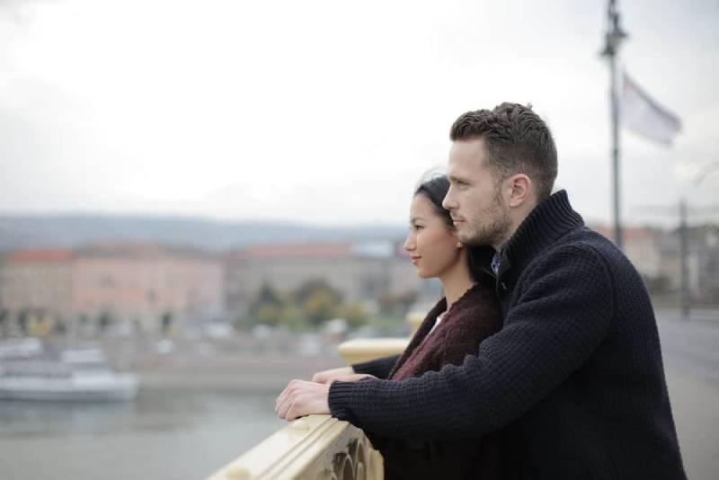 couple standing on the bridge