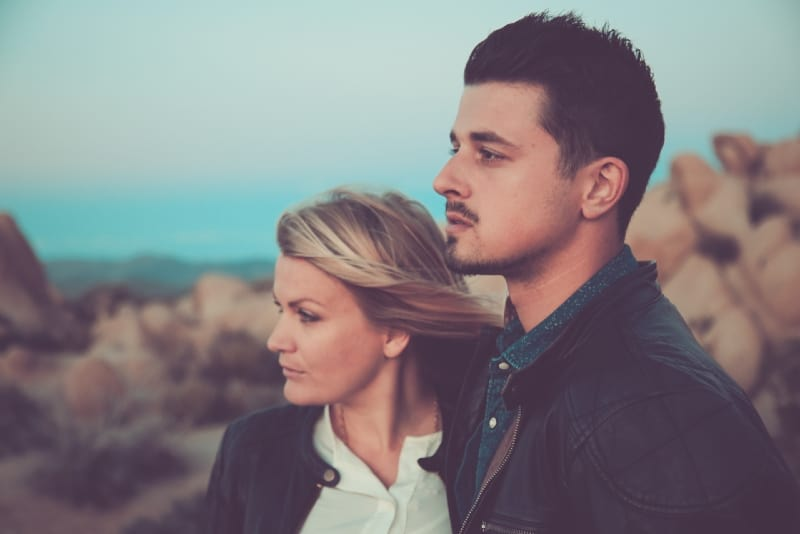 blonde woman and man standing outdoor