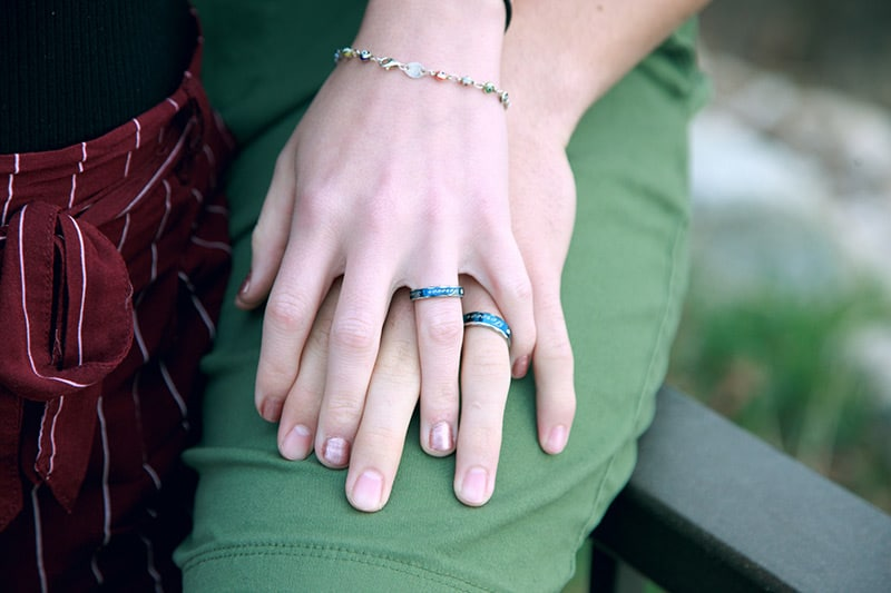 Couple's hands wearing matching rings