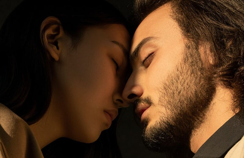 couple's head close to each other with both eyes closed