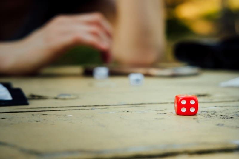 red dice on wooden table