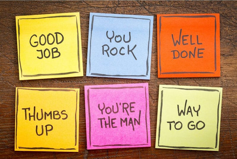 different colored sticky notes with words of encouragement