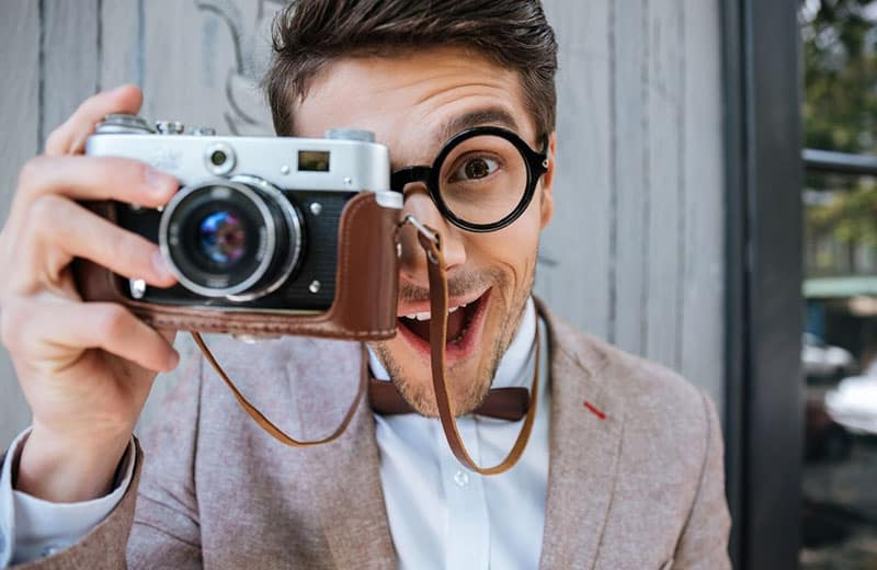 dork man with camera in formal top suit