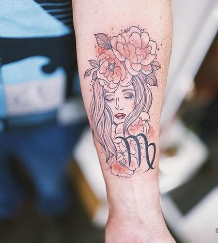 feminine portrait tattoo with Virgo sign on the arm