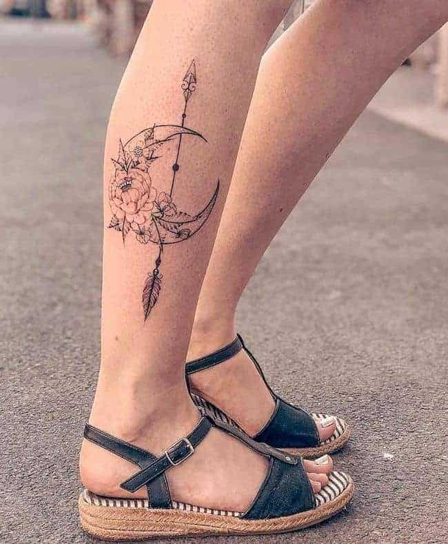 floral moon with arrow tattoo on the leg
