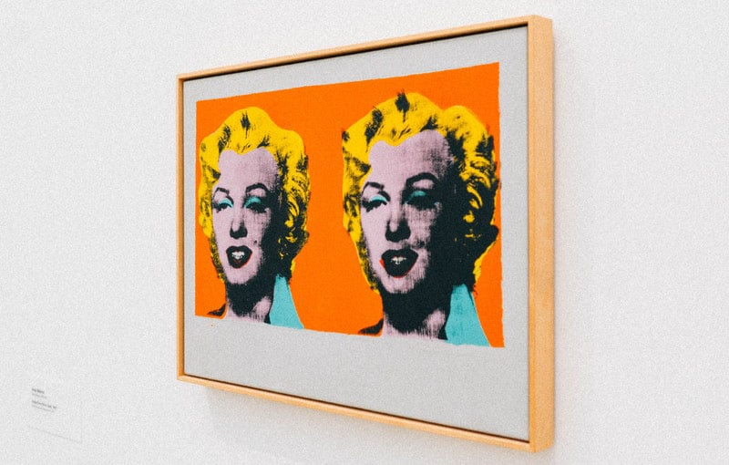 framed portrait of marilyn monroe placed on a white wall