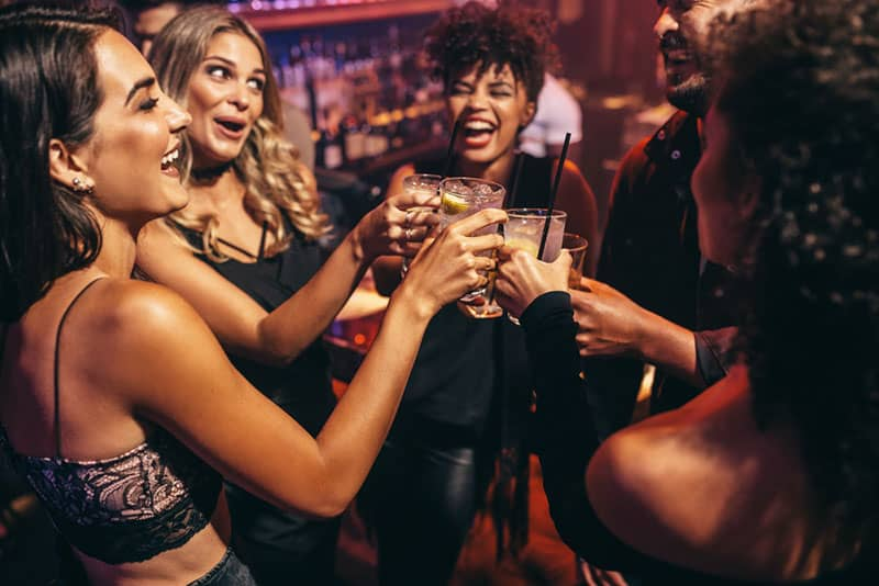 friends making a toast in the club