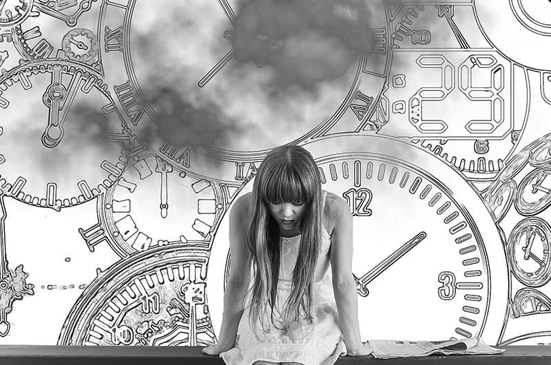 girl with timepiece as background in black and white