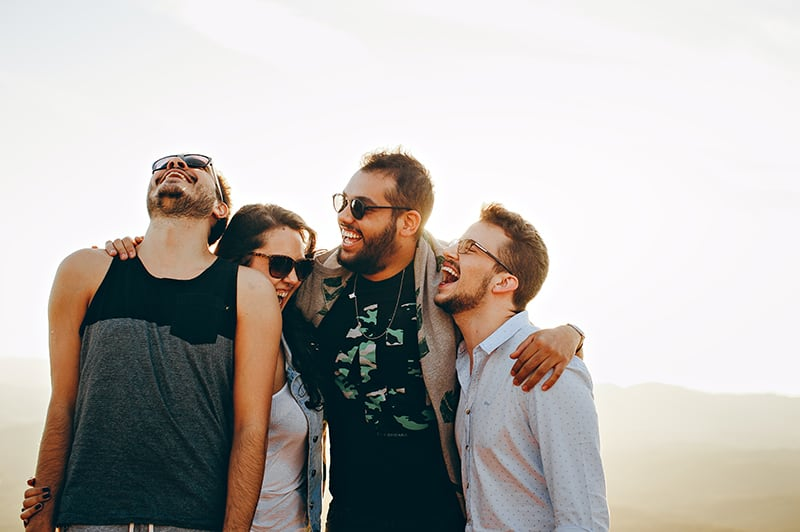group of people laughing and hugging