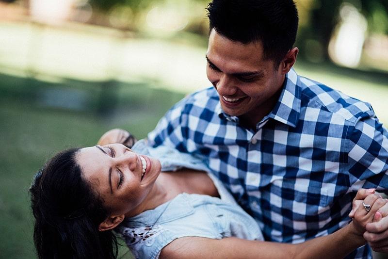 happy couple dancing outdoor
