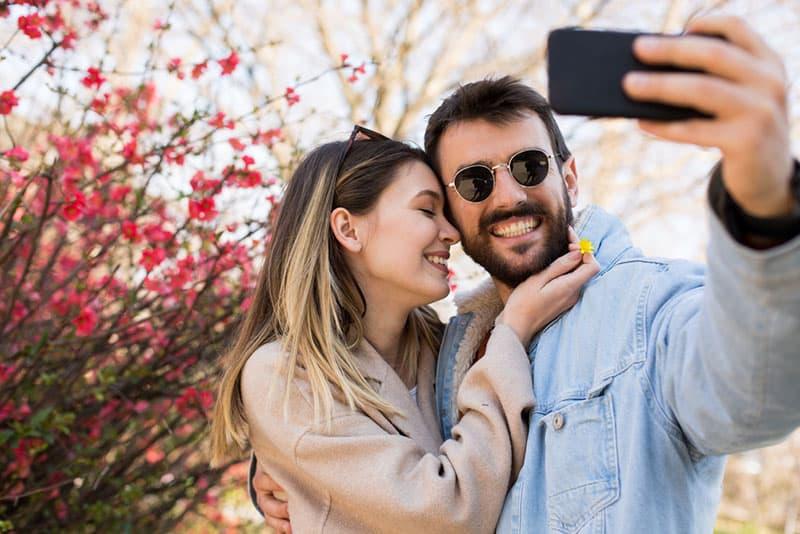 happy couple taking selfie