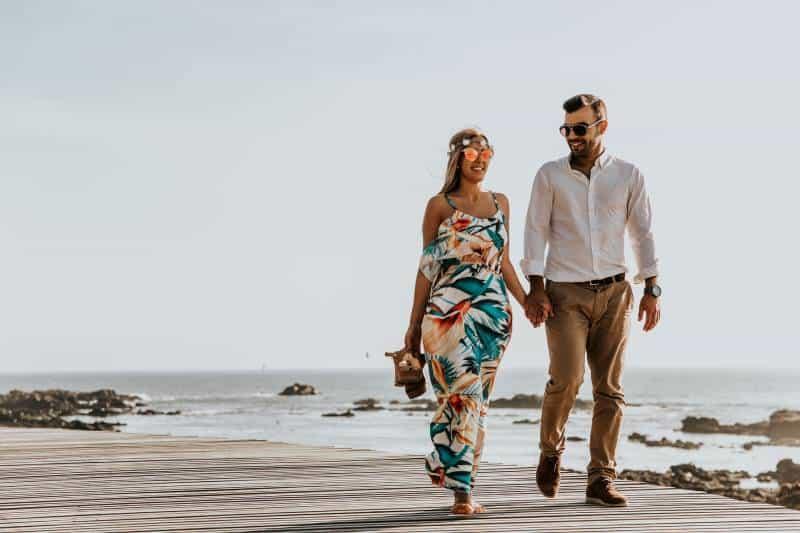 happy couple walking on the beach