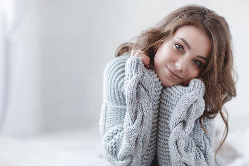kind woman in sweater posing