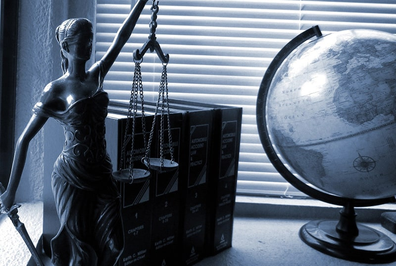 lady justice figure on the desk