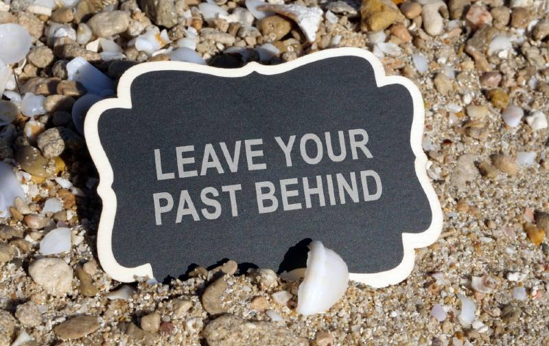 Tag with the words leave your past behind on it