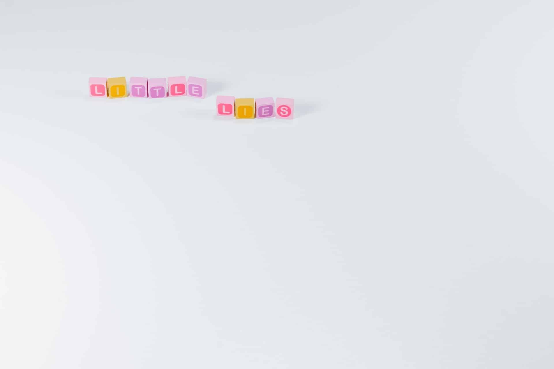 little lies caption made of letter blocks