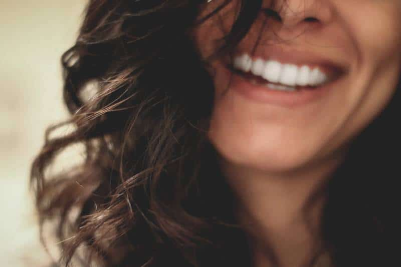 long black haired woman smiling