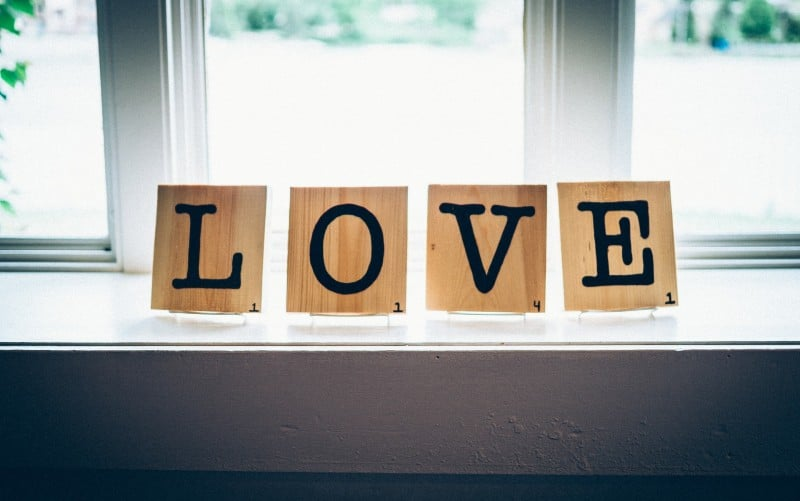 Love word written with wood squares
