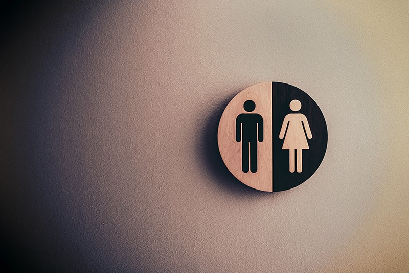 male and female signage on the wall
