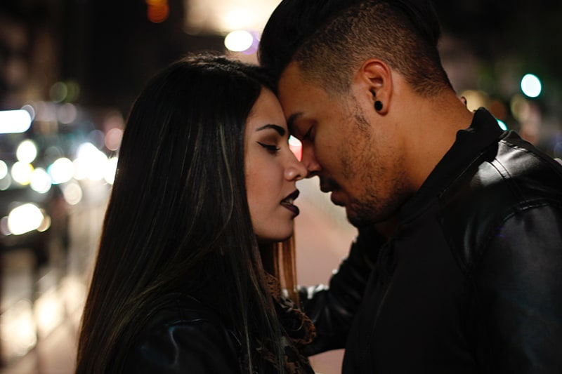 man and woman about to kiss each other while standing
