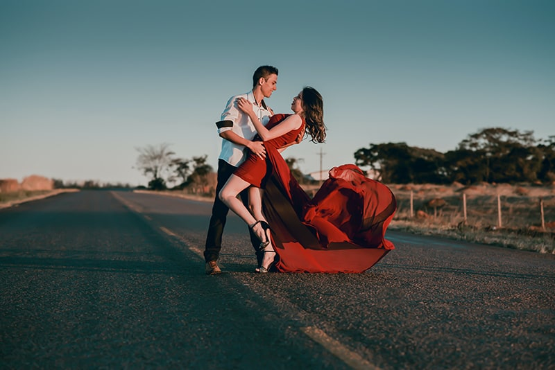man and woman dancing on the road
