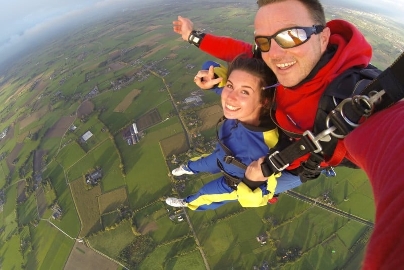man and woman wearing overalls doing skydiving