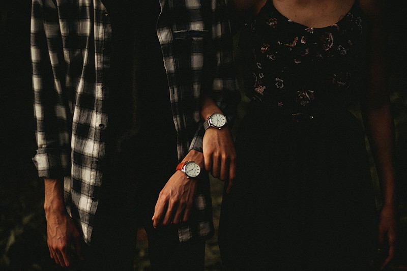 man and woman standing while holding hands