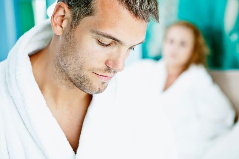 man in white robe beside woman in white robe