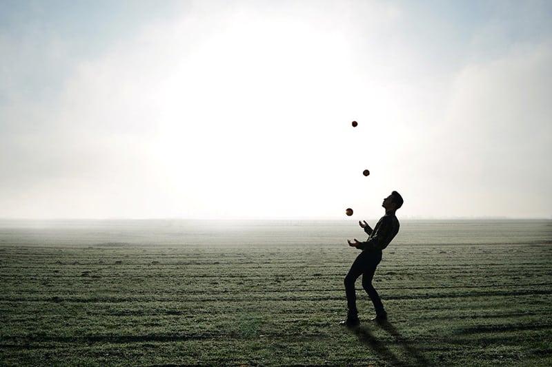 man juggling in the field