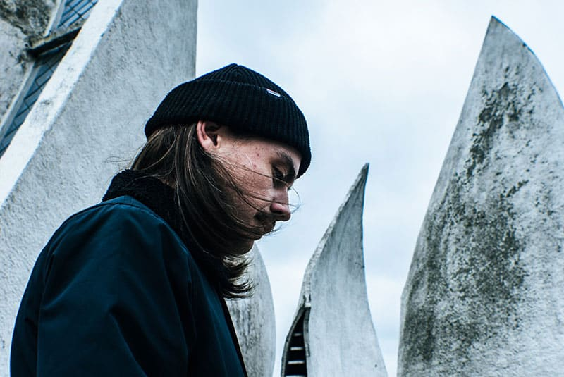 Man long hair sad look winter outdoors