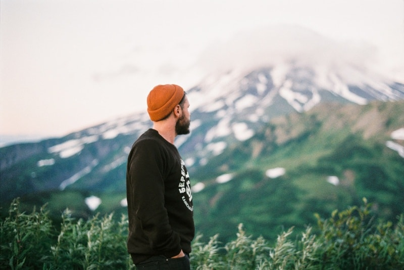 bearded man looking at mountain